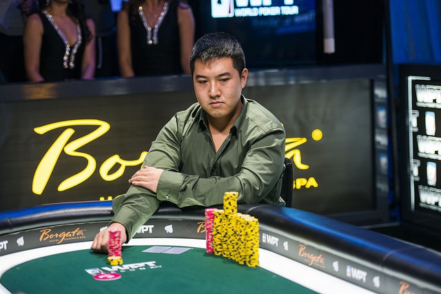 Chris Leong, pictured in an unreported hand moving all-in, just won a sizable pot with pocket kings. He's now controlling a 2:1 heads up advantage with just a few minutes remaining in Level 37.